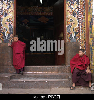 Monks at the entrance of Rinpung Dzong, Paro Valley, Paro District, Bhutan - Stock Photo