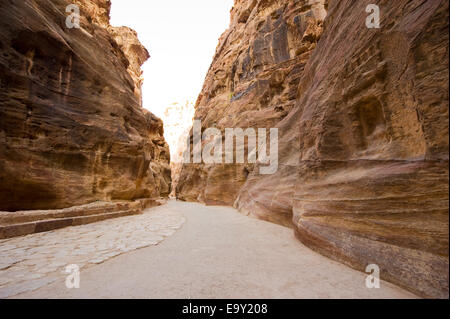 'The Siq' is a narrow gorge who leads visitors into Petra in Jordan, it is 1,2 kilometers long. - Stock Photo