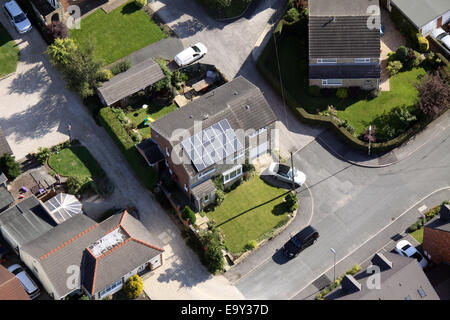aerial view of a domestic house with solar panels on the roof, UK - Stock Photo