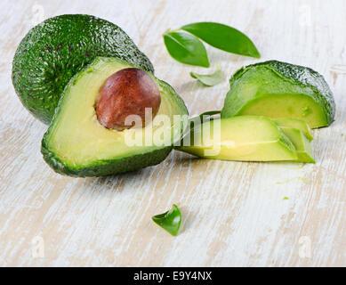 Avocado on a wooden table.Selective focus - Stock Photo