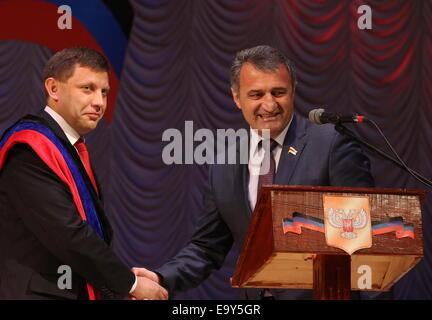 Donetsk, Ukraine. 4th Nov, 2014. Alexander Zakharchenko (L) receives congratulations from Speaker of the South Ossetian - Stock Photo