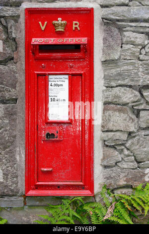 An attractive antique Victorian post box in a cottage wall near Grasmere, Lake District, Cumbria, England - Stock Photo