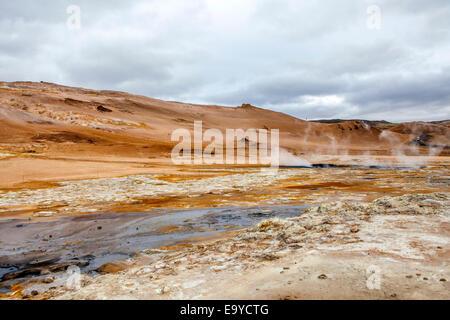Geothermal region of Hverir in Iceland near Myvatn Lake, with fumaroles venting pressurised gases, sulphur springs - Stock Photo