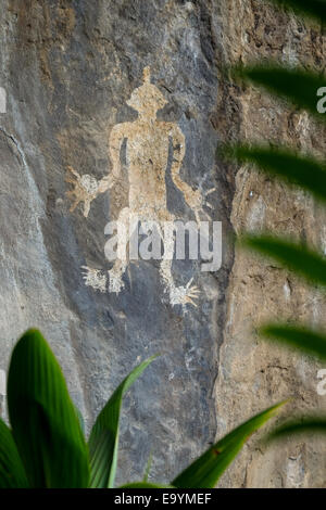 Archaeological rock painting at a small village of Lamagute in Lembata Island, Indonesia. - Stock Photo