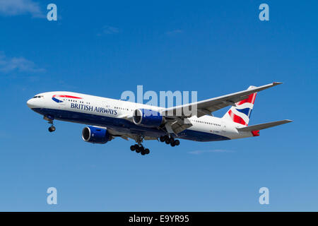 British Airways Boeing 777 plane, G-YMMP, on its approach for landing at London Heathrow, England, UK - Stock Photo