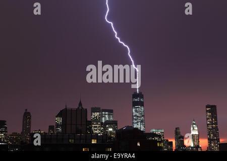 Lightning from a heavy thunderstorm over Manhattan strikes One World Trade Center - Stock Photo