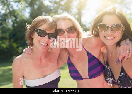Portrait of three mature women in swimwear - Stock Photo