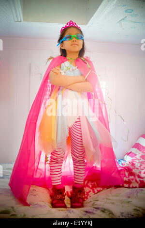 Portrait of young girl wearing fancy dress costume - Stock Photo