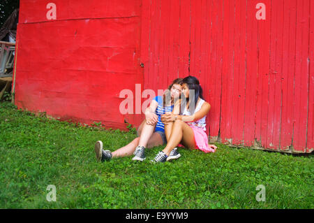 Two teenagers relaxing outdoors - Stock Photo