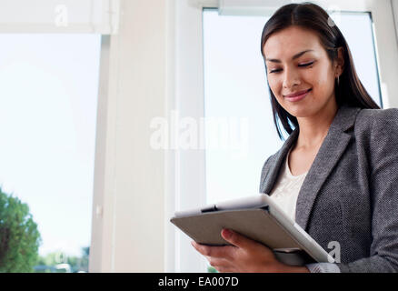Young businesswoman woman using digital tablet in office