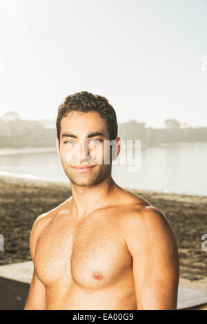 Portrait of handsome young man on Pacific beach, San Diego, California, USA - Stock Photo