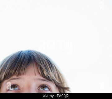 Cropped close up portrait of girl looking upward - Stock Photo