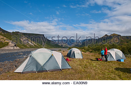 Couple chatting at campsite Basar, Thorsmork, South Iceland, Iceland - Stock Photo