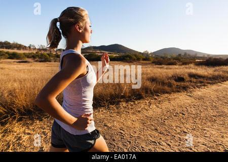 Young woman jogging, Poway, CA, USA - Stock Photo
