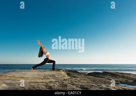 Warrior pose, Windansea beach, La Jolla, California - Stock Photo