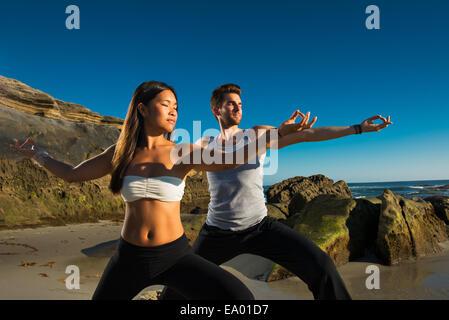 Warrior 2 pose, Windansea beach, La Jolla, California - Stock Photo