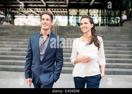 businesswoman and man chatting whilst walking, London, UK - Stock Photo