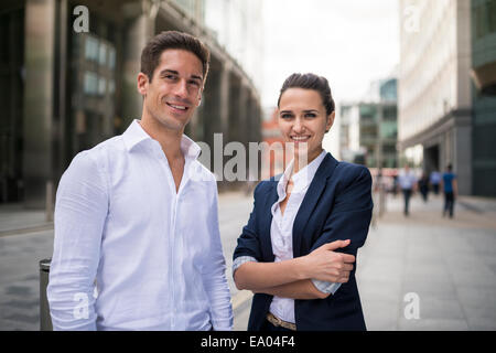 Portrait of young business partners on street, London, UK - Stock Photo