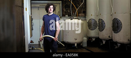 Portrait of a brewery worker in his working environment - Stock Photo