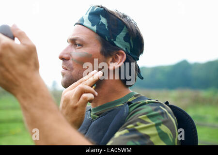 Paintball player in combat gear - Stock Photo