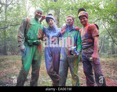 Paintball players in paintball wear marked with paint - Stock Photo