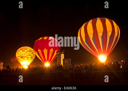 Hot air balloons at night in the Arava, Israel - Stock Photo