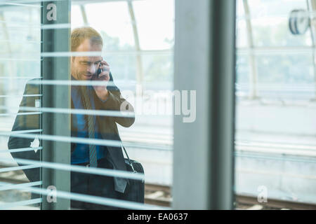 Mature man on cell phone - Stock Photo