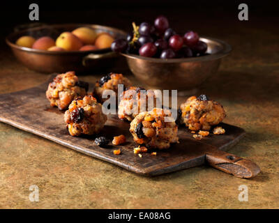 Festive Christmas ingredients of pork, apricot & jumbo flamed raisin stuffing with red grapes and apricots - Stock Photo