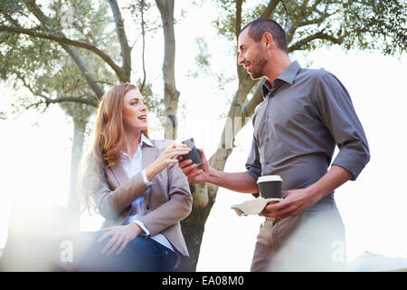 Businessman and business woman having coffee - Stock Photo