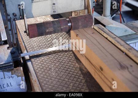 Wood block on conveyor in factory, Jiangsu, China - Stock Photo