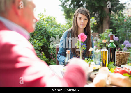 Young woman having lunch outdoors - Stock Photo