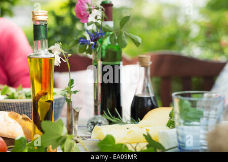 Oils and vinegar on table, close up - Stock Photo