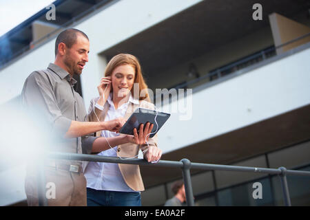 Businessman and business woman using digital tablet - Stock Photo