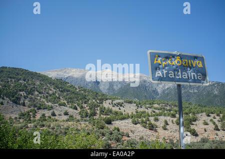 Bullet ridden sign, Aradaina, Crete - Stock Photo