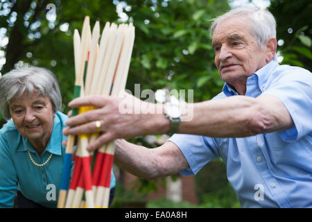 Grandfather and grandmother with giant pick up sticks - Stock Photo