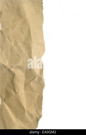 torn crumpled brown paper isolated on white background - Stock Photo