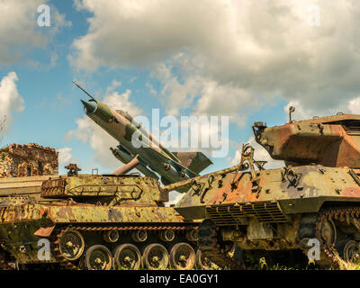 Jet Fighter and tank combination view. - Stock Photo