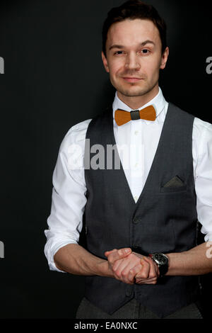 man in suit with bow-tie - Stock Photo