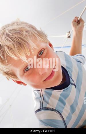 Portrait of boy on sailboat - Stock Photo