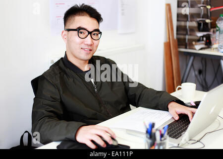 Portrait of male architect at office desk - Stock Photo