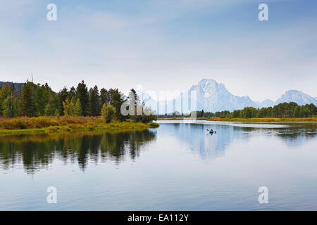 Paddling the calm waters of Oxbow Bend by kayak in Grand Teton National Park, Wyoming, USA