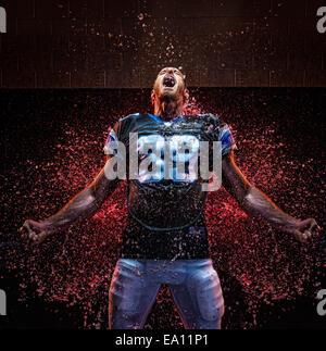Football player clenching fist - Stock Photo