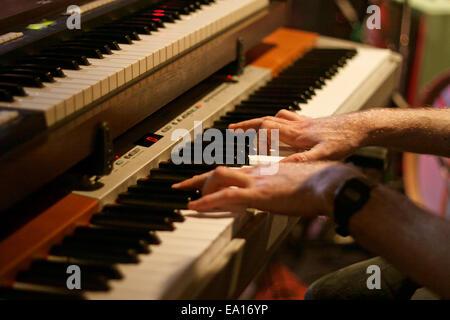 Hands on organ piano - Stock Photo