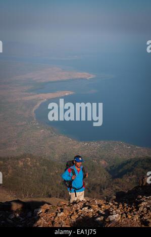 A mountain climber atop Mount Lewotolok, Lembata Island, Indonesia. - Stock Photo
