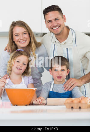 Family baking cookies at kitchen counter - Stock Photo