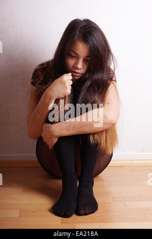 young woman with scars from self-harm - Stock Photo