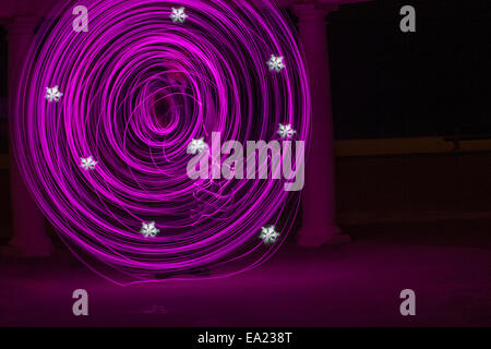 purple pink swirls with white snowflake patterns - abstract painting with light, light painting - Stock Photo