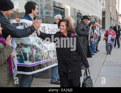 Detroit,  Michigan, USA. 5th November, 2014. Palestinian-American activist Rasmea Odeh, 67, greets supporters as - Stock Photo