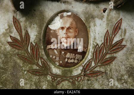 Broken photo at the grave of Soviet military officer Ivan Schelkov at the Soviet Garrison Cemetery in Dresden, Saxony, - Stock Photo