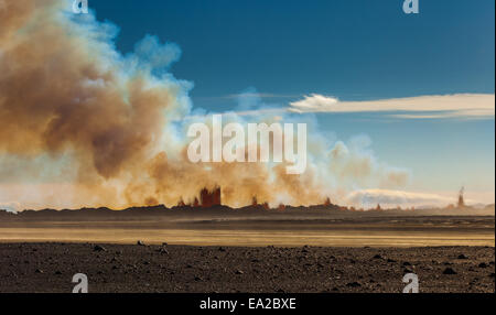 midday view in sun over the iceland volcano eruption - Stock Photo